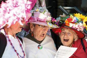three-women-singing-from-same-hymn-sheet